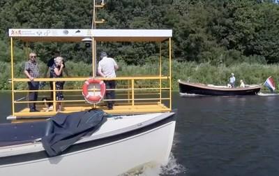 Autonomous robotaxi solar electric commercial ferry service boat navigating dense marine traffic.