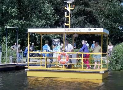 Autonomous robotaxi solar electric commercial ferry service boat leaving dock with Dutch passengers.