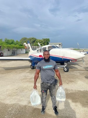 Getro Deliscas, GivePower's Solar Water Farm Site Manager in Haiti, delivers the first shipment of clean water to areas hard-hit by Saturday's earthquake.