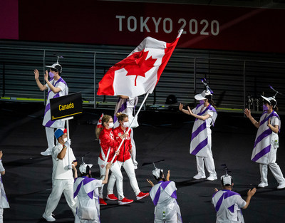Para judoka Priscilla Gagné (Sarnia, ON) carries the flag for Canada at the Opening Ceremony on August 24, alongside guide and training partner Laurie Wiltshire (Calgary, AB). PHOTO: Canadian Paralympic Committee (CNW Group/Canadian Paralympic Committee (Sponsorships))